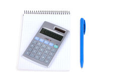 Calculator and notebook with blue pen  on white Stock Photo