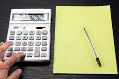 Calculator and notebook Stock Images
