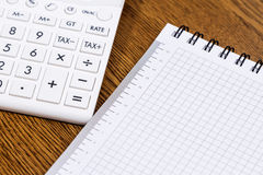 A calculator and a notebook Stock Images