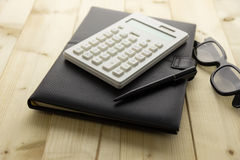 Calculator and Notebook on Desk Royalty Free Stock Photos