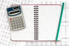 Calculator and notebook on financial statement. Stock Photo