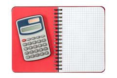 Calculator and notebook ,isolated on white. Digital calculator and spiral notebook ,isolated on white background Stock Photo