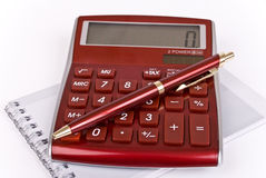 Calculator, notebook and pen Royalty Free Stock Images