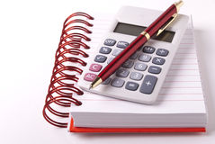 Calculator, notebook and pen Stock Image