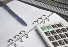 Calculator on Notebook with pen Royalty Free Stock Photography