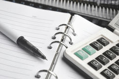 Calculator on Notebook with pen Stock Image