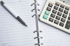 Calculator on Notebook with pen Stock Images