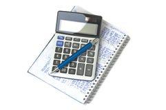 Calculator, notebook and pen Stock Photos