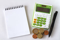 Calculator Notebook and Pen on White Background. Royalty Free Stock Photography