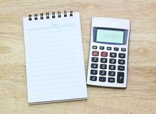 Calculator and notebook on table Royalty Free Stock Image