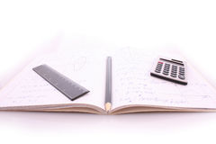 Calculator on notepad Stock Photography
