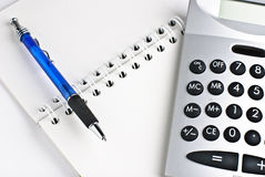 Calculator with notepad. Calculator with a notepad isolated on a white background Stock Photo