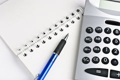 Calculator with a notepad. Isolated on a white background Stock Photos