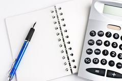 Calculator with notepad. Calculator with a notepad isolated on a white background Stock Photography