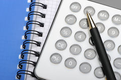 Calculator and notepad Stock Photos