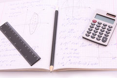 Calculator on notepad with calculations Stock Image