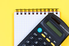 Calculator and notepad close-up. Royalty Free Stock Photo