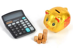 Calculator and notepad with coins Royalty Free Stock Photos
