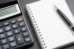 Calculator and notepad Stock Image