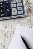 Calculator, notepad and pen Stock Photos
