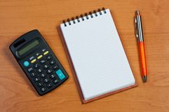 Calculator, notepad and pen. Stock Photography