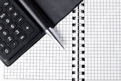 Calculator with notepad and pen Royalty Free Stock Photography