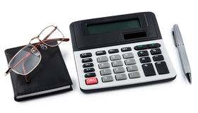 Calculator, notepad, pen and glasses isolated on white Royalty Free Stock Photography