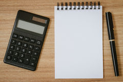 Calculator, notepad and pen Royalty Free Stock Photos