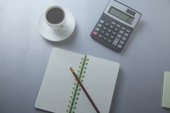 Calculator and notepad on the table royalty free stock photos