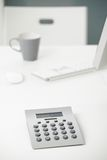 Calculator on office desk. Close-up photo of calculator on office desk Royalty Free Stock Images