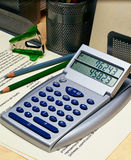 Calculator on an Office Desk Stock Images