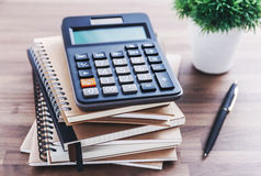 Calculator on office desk Royalty Free Stock Photos