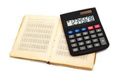 Calculator with an old book Royalty Free Stock Photography