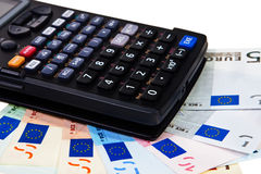 Calculator onto Euro banknotes. Stock Image