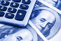 Calculator op de dollars van de V.S. Stock Afbeeldingen