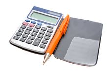 Calculator and orange pen Royalty Free Stock Images