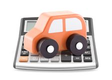 Calculator and orange toy car Stock Photography