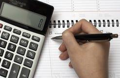 Calculator, organizer and pen 2. Close up of a calculator, organizer and pen Royalty Free Stock Image