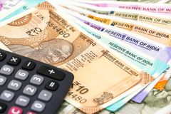 Free Calculator Over Brand New Indian 10, 50, 100, 200, 500 And 2000 Rupees Banknotes. Colorful Money Background Stock Image - 135892041