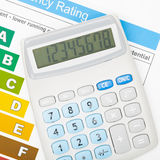 Calculator over energy efficiency chart - close up Royalty Free Stock Photo