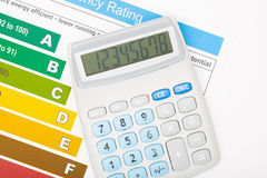 Calculator over energy efficiency chart Stock Photography