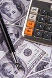 Calculator over Geld royalty-vrije stock afbeelding