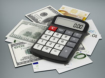 Calculator and paper currencies Royalty Free Stock Image