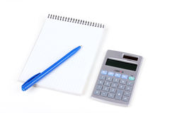 Calculator and paper notebook with blue pen Royalty Free Stock Image