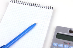 Calculator and paper notebook with pen Royalty Free Stock Images
