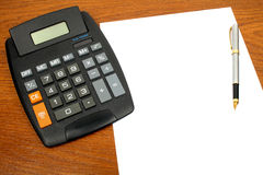 Calculator, paper, pen Stock Images