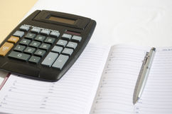 Calculator paper and pen. Background Stock Photos