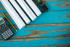 Calculator, paper scrolls, pencil and level tool Royalty Free Stock Photos
