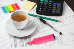 Calculator, papers, pen,  pencil and cup of coffee Stock Photo
