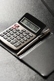 Calculator with a pen Stock Photos